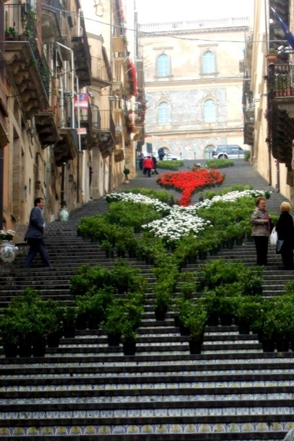 Flowers on the staircase in Caltagirone, Sicily Photo by Margie Miklas