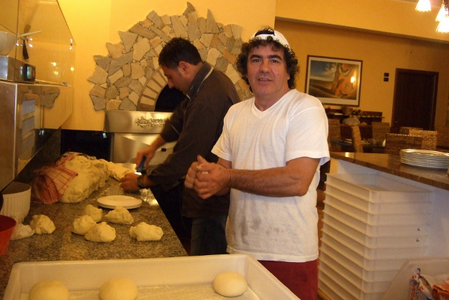 Pizza makers in Sicily