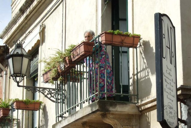 Sicilian woman on her balcony