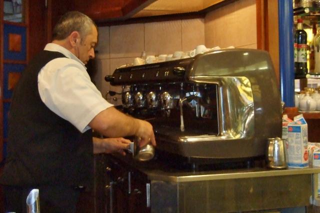 Preparing cappuccino at Bar Quadrani