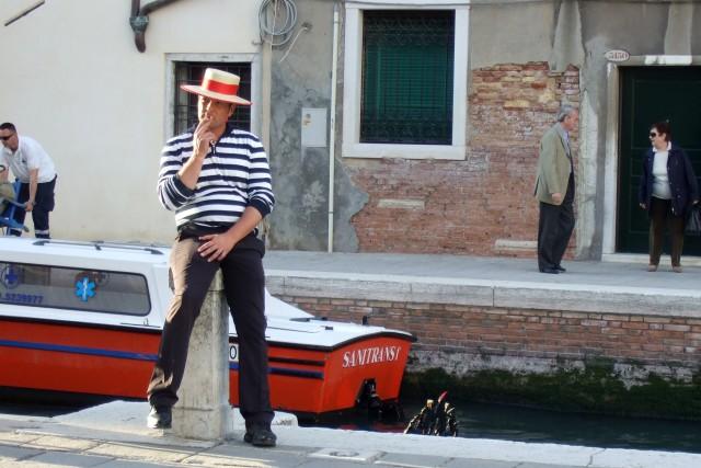 Venice gondolier taking a smoke break Photo by MARGIE MIKLAS