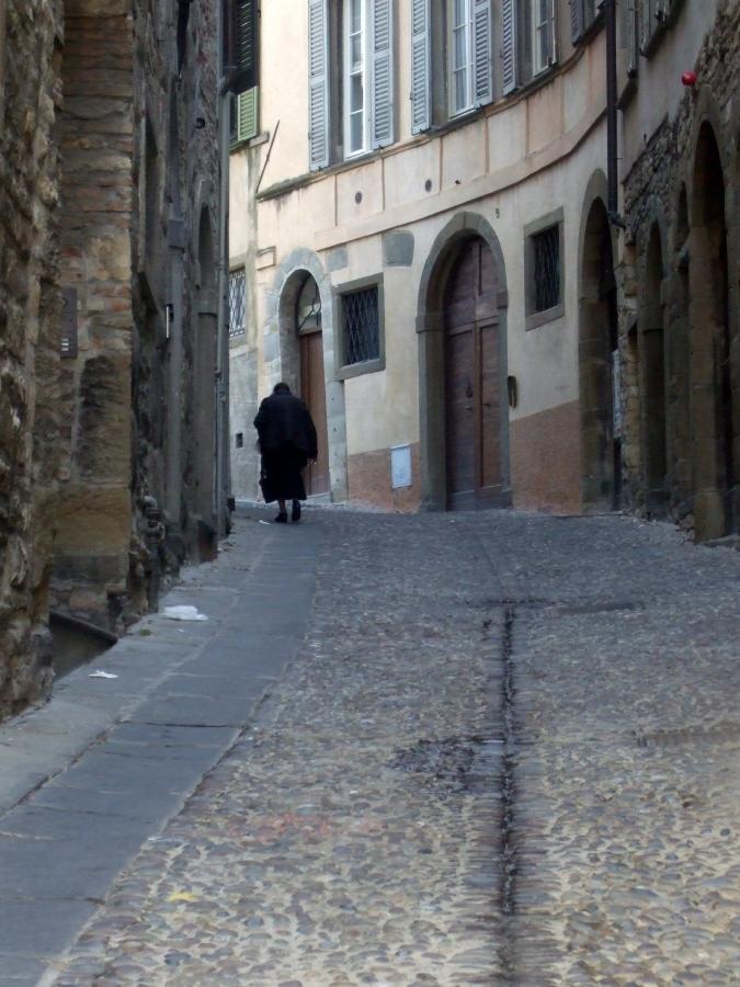 Italian woman walking uphill in Bergamo Photo by Margie Miklas