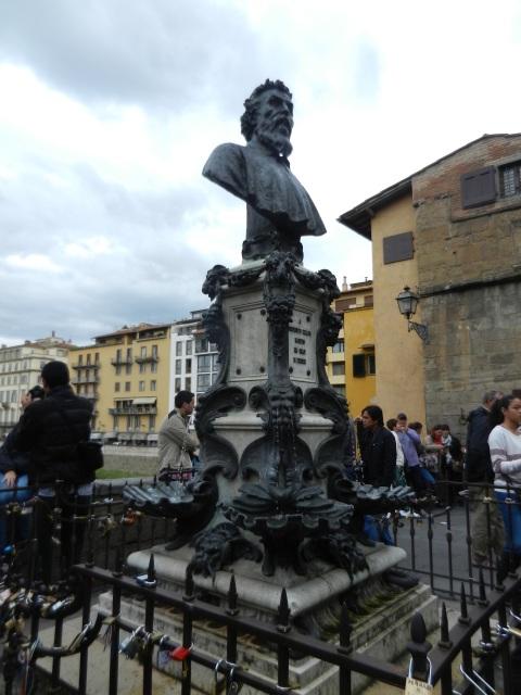 Love locks on railing around sculpture of Cellini