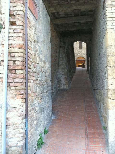 San Gimignano narrow walkway Photo by Margie Miklas