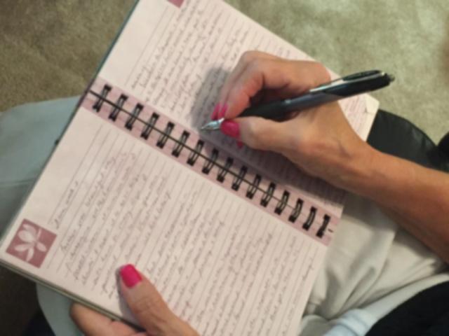 Margie writing Photo by Margie Miklas