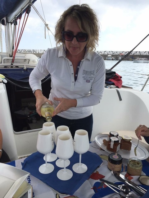 Maria Letizia pouring prosecco while sailing in Taormina Photo by Margie Miklas